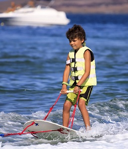 Child ski boarding in the Algarve
